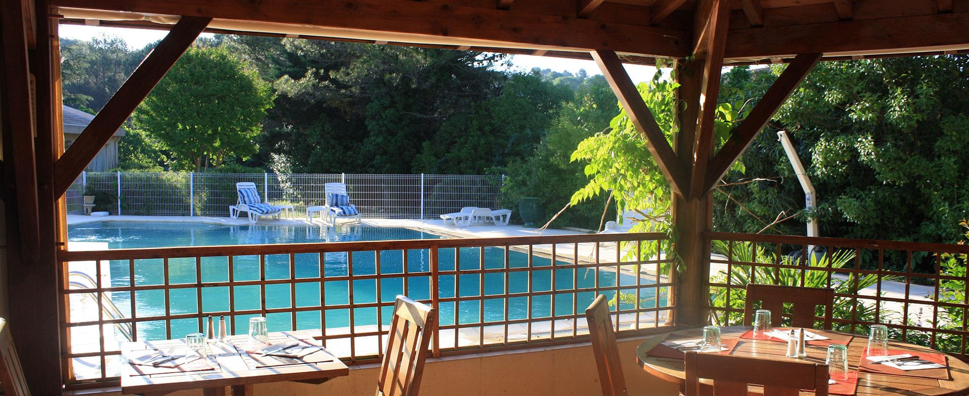 View across the pool from the terrace of the hotel Saint Benoit located in Hérault